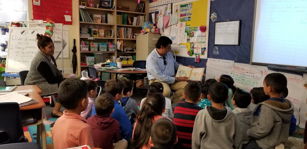 Aaron Martinez reading to children at Orr Elementary